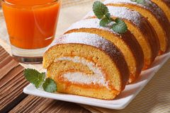 Tasty dessert of pumpkin roll with cream closeup Royalty Free Stock Photography