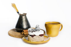 Tasty dessert on the round plate with cup of coffe Stock Images
