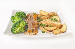 Tasty dinner - roast veal with fried potatoes and broccoli isola. Ted on white background Royalty Free Stock Image