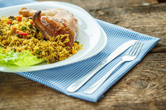 Tasty dish of chicken thigh with rice Royalty Free Stock Image