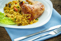 Tasty dish of chicken thigh with rice Stock Photos