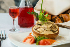 Tasty dish with mushrooms in a restaurant Stock Images