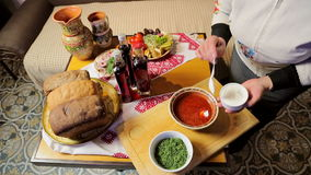 Tasty dishes of traditional ukrainian and Russian food prepared for a dinner of few people. stock footage