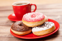 Tasty donut with a cup of coffee Stock Images