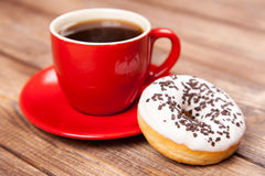 Tasty donut with a cup of coffee Royalty Free Stock Photos