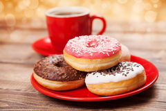 Tasty donut with a cup of coffee Stock Photo