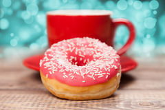 Tasty donut with a cup of coffee Stock Image