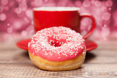 Tasty donut with a cup of coffee Stock Photography
