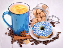 Tasty donut with a cup of coffee Stock Photos