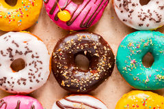 Tasty donuts on paper Stock Image