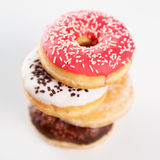 Tasty donuts on white background Royalty Free Stock Images