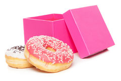 Tasty donuts on white background Stock Photos