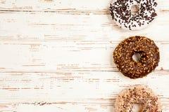 Tasty donuts on white wood background Stock Photo