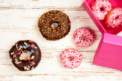 Tasty donuts on white wood background Royalty Free Stock Image