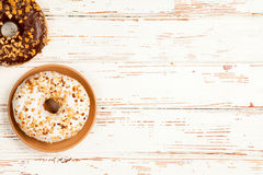 Tasty donuts on white wood background Stock Photos