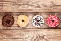 Tasty donuts on a wooden table Royalty Free Stock Image