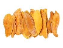 Tasty dried mango slices detailed. Close up  on white background Royalty Free Stock Images