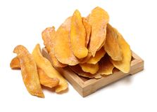 Tasty dried mango slices detailed. Close up  on white background Royalty Free Stock Photos