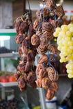 Dried persimmon Diospyros kaki on the street market in Georgia stock photo