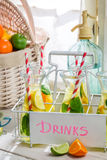 Tasty drink with lime and lemon Royalty Free Stock Photos