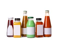Tasty drinks in bottles with blank labels on white background. Mock up for design royalty free stock photos