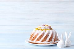 Easter cake with ceramic rabbits royalty free stock image