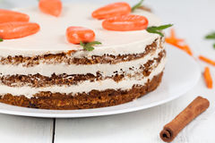 Tasty easter carrot cake with cream and little Royalty Free Stock Images