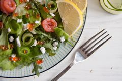 Green salad with salmon, cucumber, cream cheese and caviar Royalty Free Stock Photo