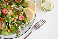 Green salad with salmon, cucumber, cream cheese and caviar Stock Photography