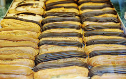 Tasty eclairs on in french bakery store Royalty Free Stock Image