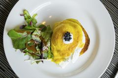 Tasty egg Benedict served on the white plate Royalty Free Stock Photography