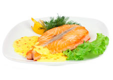 Tasty fillet of a salmon on a white Stock Photo