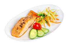 Tasty fillet of a salmon on a white Stock Images
