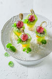 Tasty finger food with various fruits and mint for party Royalty Free Stock Images