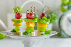 Tasty finger food with various fruits and mint for snack Royalty Free Stock Photo