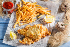 Tasty fish and chips in newspaper Stock Images