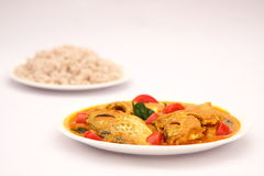 Tasty fish curry dish served with cooked rice, Royalty Free Stock Photo