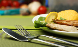 Tasty fish with lemon and vegetables Stock Photography