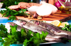 Tasty fish with parsley and lemon. Trout with parsley and lemon at the table at home Royalty Free Stock Photography