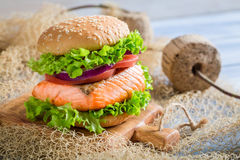 Tasty fishburger with salmon Stock Photo
