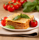 Tasty flavorful lasagna on a plate and ingredients Stock Photography