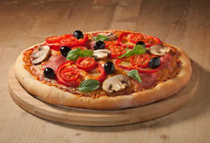 Tasty, flavorful pizza on the board Royalty Free Stock Image