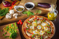 Tasty, flavorful pizza  on white background view on top. Royalty Free Stock Images