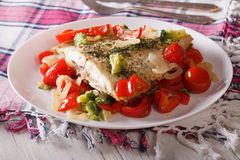 Tasty flounder with seasonal vegetables close-up. horizontal Stock Photography