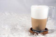 Tasty foamy coffee. In a glass Stock Image