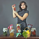 About tasty food. The young woman tells preparation tasty health peeping meal Stock Photography