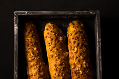 Tasty food. French crisply baguette close-up on a black backgrou Royalty Free Stock Photo