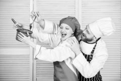 Tasty food and good company. secret ingredient by recipe. cook uniform. man and woman chef in restaurant. couple in love stock photo