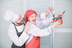 Tasty food and good company. secret ingredient by recipe. cook uniform. man and woman chef in restaurant. couple in love royalty free stock images