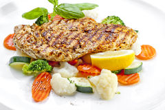Tasty food. Grilled chicken breasts and vegetables . High qualit Stock Images